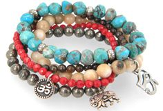 This bracelet is made of turquoise, bone jasper, pyrite and coral with lucky charms. Perfect to stack on your arm for this summer! €87 from Lacey Ryan
