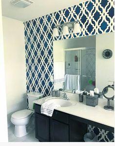 A DIY stenciled bathroom accent wall using the Tamara Trellis Stencil from Cutting Edge Stencils. Project viaBeautiful on the Inside