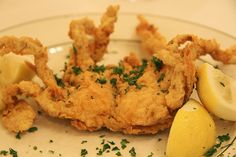 fried soft shell crabs, its prepared with a light batter, deeply fried ( I know watching your weight, but cmon live a little) it is usually topped off with green onions or sliced jalapenos,