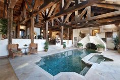 A little pool right in this rustic home...an HVAC nightmare I am sure, but cool!