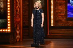 Songwriter Carole King speaks onstage during the 70th Annual Tony Awards at The Beacon Theatre on June 12, 2016 in New York City in Adrianna Papell's Scoop back sequin gown.