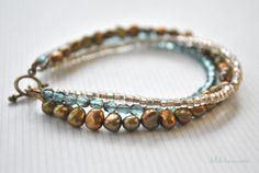 Sooo pretty for the bohemian gypsy soul - stacked beaded bracelet with gold toned pearls and czech crystals.