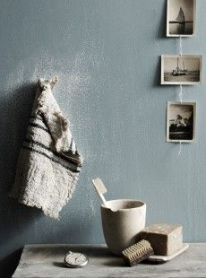 I love the rustic feel to this shot. The color of the wall behind the frameless photos, the blue and white towel...it all evokes a uniquely oceanic atmosphere.