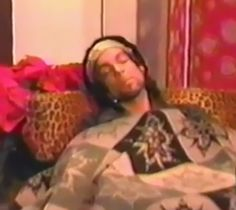 """Prince pretending to 'nap' before his appearance on MTV'S """"Total Request Live."""" He didn't perform because he had a touch of laryngitis."""
