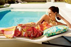 Poolside panache: A statement-making dress & supersized jewelry.