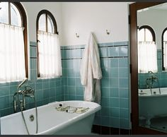 two bathrooms with bold tile beautiful turquoise and house