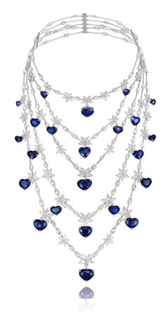 #Chopard platinum necklace encrusted with marquise and round-cut diamonds and heart-shaped sapphires.