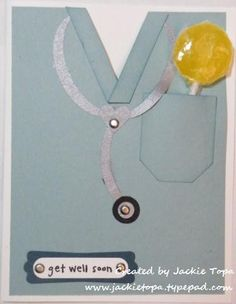 """Scrubs and Lollypops - The pocket is made from the large tag punch. I punched a small hole behind the pocket so I could insert the sucker. The stethoscope is made from the wide oval, 1/2"""" Circle and heart punches. To make the neckline, I cut a """"V"""" and glued a strip of card stock along the opening. (Oct 5, 2010)"""