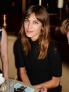 Trendsetter: Alexa Chung looked radiant in a woollen dress and natural make-up at the Busi...