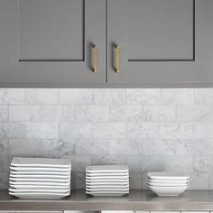 Charcoal Gray Kitchen Cabinets with Marble Subway Tiles