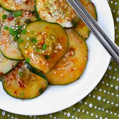 Oi Muchim (Spicy Korean Cucumber Salad)  2 teaspoons rice vinegar,  1-2 teaspoons gochugaru (Korean red pepper powder),  1 teaspoon toasted sesame oil,  1 teaspoon toasted sesame seeds,  1/2 teaspoon salt,  1/2 teaspoon sugar,  1 scallion, chopped  2 Kirby cucumbers, sliced 1/8-inch thick