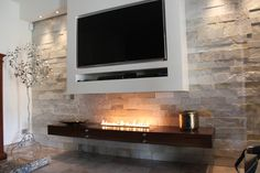 TV mounted over a bio ethanol fireplace Bioethanol Fireplace, Modern Fireplace, Fireplace Wall, Fireplace Design, Fireplace Ideas, Fireplaces, Tv Entertainment Centers, Fireplace Inserts, Wall Mounted Tv