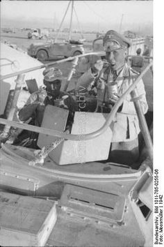 "North Africa, 1942 - General Field Marshal Erwin Rommel in the light armoured car Sd.Kfz. 250/3 ""Greif""."