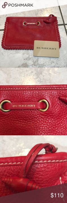 DOOR BUSTER!!!!!NWT BURBERRY RED LEATHER CLUTCH absolutely love this RED LEATHER MINI CLUTCH BY BURBERRY. Perfect for a night out ! Holds all the essentials!! Love love love ! Makes a perfect holiday gift or keep it for yourself because it's gorgeous Burberry Bags Clutches & Wristlets
