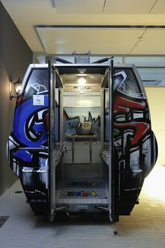 Google Graffiti Gondola - Real Swiss ski gondolas converted into creative phone booth for the amazing Google Zurich offices