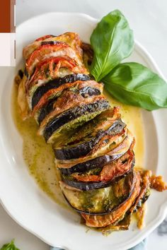 Have you ever tried roasting eggplant? Our tasty Roasted Eggplant Recipe is a vegetarian dinner of roasted eggplant slices stuffed with mozzarella, tomato, and pesto! We'll show you how to roast eggplant in the oven for the best texture and flavor. If you love Italian dishes like caprese, this is a perfect recipe for you! #SundaySupper #eggplantrecipes #roastedeggplant #eggplant #easyrecipes #dinners Italian Eggplant Recipes, Best Eggplant Recipe, Vegetarian Italian, Vegetarian Recipes Dinner, Vegetable Recipes, Stuffed Eggplant Recipes, Italian Dishes, Recipes With Eggplant, Vegetarian Eggplant Recipes