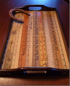 Old yardsticks becomes a clever tray. If you don't like the rustic look, you can always paint them.