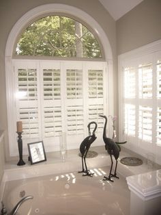 Love the plantation shutters and the bird sculptures.  Relaxing Bath Tub Color Scheme - contemporary - bathroom - charlotte - Color Specialist, Charlotte