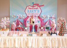 Carnival/circus themed sweets table that I created for my daughter's 6th birthday, complete with circus tent cake, clown cupcakes, circ...