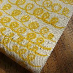 twist  screenprinted fabric in sunburst yellow on by summersville, £5.00