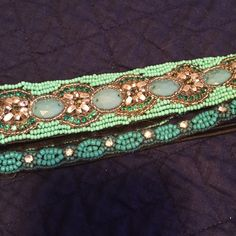 Two teal beaded headbands Two beaded headbands. Not sure where I got the thick one. The thin one is from Maurices. Both have velvet back so it doesn't slip out of your hair. Also both have stretchy elastic parts. All beads are in place. Both very beautiful if you'd like to separate the bundle let me know. Maurices Accessories Hair Accessories