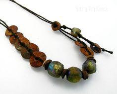 another angle of my new Bronze Moon Goddess; bronze with Basha beads on hand-plied linen; kathy van kleeck