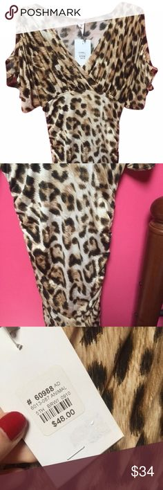 Sexy Trendy Leopard Dress New with Tags Size Small This dress is so gorgeous! It is fitted with cinched detail in the lower half, and loose and flowing throughout the sleeves. There are loops for a belt. The cold shoulder sleeves and animal print add a trendy twist. It's a size small and brand new with tags.  All of my items come from a smoke free home.  Please comment below if you have any additional questions.  NO SWAPS. Yes to bundle discounts and offers. :) Dresses