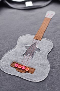 How cute would this be as a quilt block? 'Superstar' Acoustic Guitar tee | 12/18 months by LRstitched, via Flickr