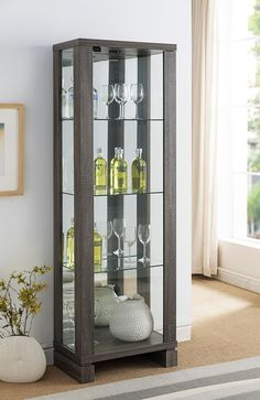 "Smart Home Wine Bar Edition Curio Display features an all around finish in Distressed Grey. This Wine Cabinet Curio has for shelves for extra display space. Each Curio has LED lights on it's top. The product dimensions are approximately 13.75""D x 23.25""W x 69""H. Assembly is required."