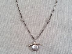Handmade Dove Grey Coin Pearl with Sterling Bar Necklace. Handmade by our friends at J&I Jewelry, in their Philadelphia studio.