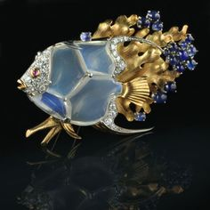 Moonstone and sapphire fish pin by Marcus & co.. At Hancocks & Co (Jewellers) Ltd.