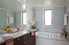 the light blue walls with the marble is beautiful.Marble tile surrounds the spacious bathtub in this contemporary bathroom. The marble combined with the room's soft blue walls creates a calm and soothing environment. Blue Bathroom Decor, White Bathroom, Master Bathroom, Bathroom Ideas, Mosaic Bathroom, Light Bathroom, Vanity Bathroom, Bathroom Inspiration, Small Bathroom