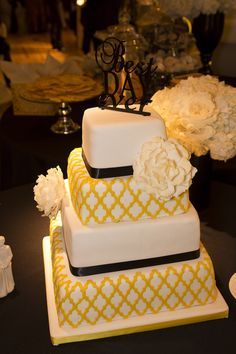 Black white and yellow cake. The baker created the pattern from our invites!