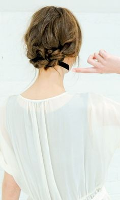 knotted bun with ribbon braided in