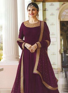 Bollywood diva prachi desai wine partywear anarkali suit online which is crafted from georgette fabric with exclusive embroidery and stone work. This stunning designer anarkali suit comes with santoon bottom, santoon inner and chiffon dupatta. Costumes Anarkali, Anarkali Dress, Pakistani Dresses, Indian Dresses, Indian Outfits, Lehenga Choli, Bridal Anarkali Suits, Pakistani Suit With Pants, Anarkali Tops