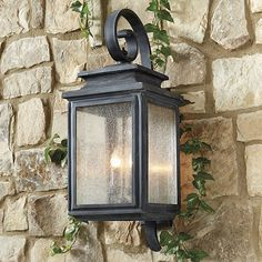 The Dawson Outdoor Lantern's weathered zinc finish, tiered top and clear heavily seeded glass give this outdoor lantern an authentic vintage look.