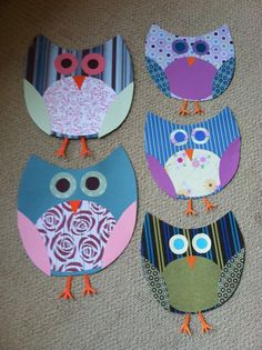 "Owls made from scrapbook paper for a ""Who's Reading"" bulletin board above our book corner."