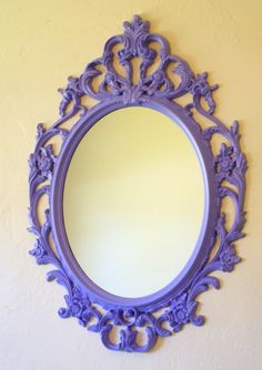 I like the idea of adding bright color to chandeliers, mirror frames, etc. They have this particular mirror (in black) at Ikea for about $40.