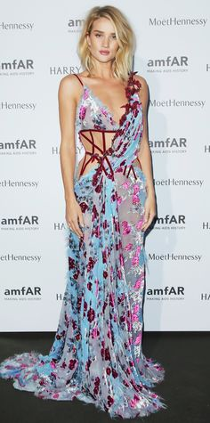Rosie Huntington-Whiteley stunned in a sheer floral gown complete with corset-like boning by Atelier Versace Couture at the amfAR dinner in Paris. Minimal makeup and loosely tousled waves finished off the fresh-off-the-runway look.