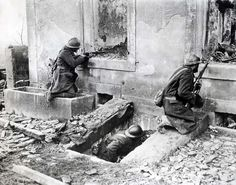 Invasion of France, 1940: French soldiers battle the German advance behind the ruins of a house at an unidentified location. Despite French superiority in numbers, the French effort collapsed within weeks under combined German thrusts and strategic initiative.