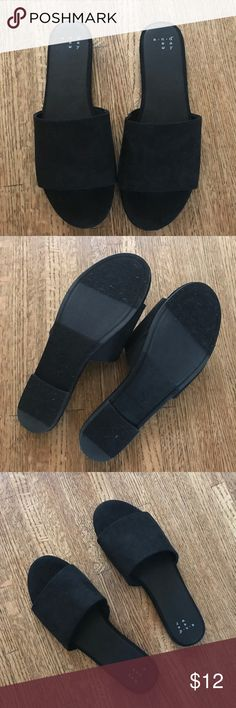 A NEW DAY mule slide sandals NWOT! Super cute and soft black mule slide sandals! Perfect to our with your favorite dress, jeans and a t shirt or simply going to the beach. Never worn, just tried on. True to size! Target Shoes Sandals