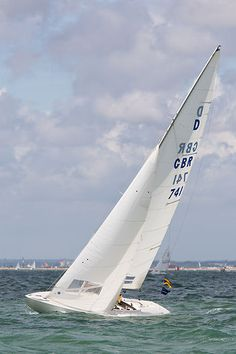 The Dragon class sailboat 'Chime' racing during Cowes Week 2013.