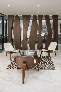 Coalesse Shell Chairs are a unique craft piece to include in a reception or casual lounge space. Coalesse Shell Chairs are a unique craft piece to include in a reception or casual lounge space.