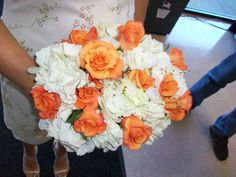 Wedding bouquet for a friends wedding Orange Roses and White Hydrangas