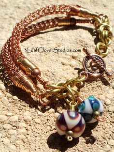 3 leaf Clover Studios - brass and copper double viking knit toggle bracelet with two borosilicate glass lampwork beads (SOLD)