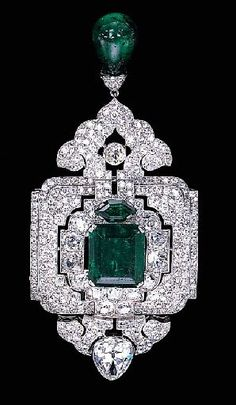 An impressive emerald and diamond pendant-brooch, by Cartier