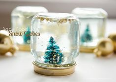 Have a bunch of baby food jars hanging around? Here's a great upcycle for all those cute little jars! Turn them into mini snow globes with a few household items. Baby Food Jar Snow Globes are easy to create and make a fantastic gift idea! Snow Globe Crafts, Diy Snow Globe, Christmas Snow Globes, Christmas Jars, Holiday Crafts, Christmas Ideas, Baby Food Jar Crafts, Baby Food Jars, Food Baby