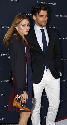 Olivia Palermo wows in preppy pleats and a plunging neckline as she joins model husband Johannes Huebl  : The couple, who regularly jet around the world together for fashion events, will celebrate their first wedding anniversary in June