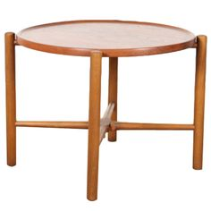 Scandinavian round coffee table. Model AT 35 by Hans J Wegner. | From a unique collection of antique and modern coffee and cocktail tables at http://www.1stdibs.com/furniture/tables/coffee-tables-cocktail-tables/