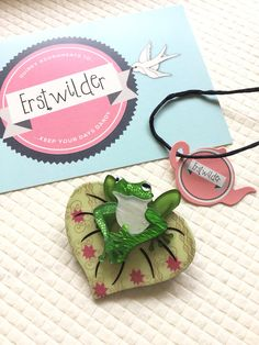 I love the colours in my new Erstwilder brooch, this guy is 'Lachy of the Lilly'.